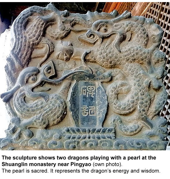 pu-two-dragons-playing-with-a-pearl.jpg